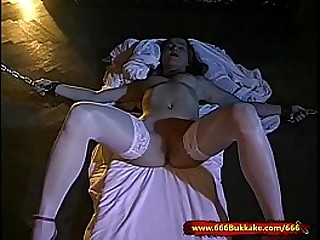 Dirty young Slut is in chains used, fucked and cum covered by a group of lickerish men!